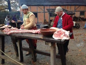 Gareth and Chris work on cutting up pork. Copyright Andrea Callicutt